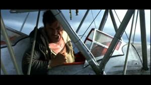 Originalet till Snakes on a plane: Indiana Jones möter piloten Jocks tama orm Reggie.